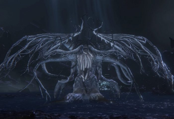 Erbrietas stands in the middle of her arena, an almost indescribable monstrosity.