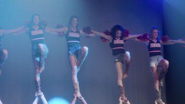 Cheerleaders being held in the air in Cheer on Neflix
