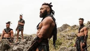 Māori warrior brooding with three other warriors behind him