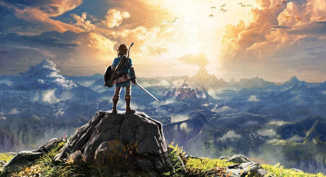 Link stands on a mountain looking out over Hyrule in artwork for Zelda: Breath of the Wild
