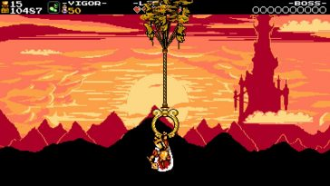 King Knight holds a big gold ring being flown by some Propeller Rats while the sun sets and the Tower of Fate looms large in the background.