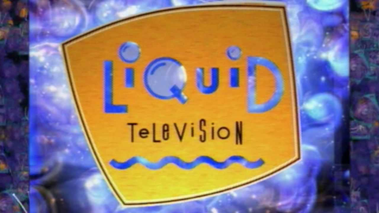 "A yellow oblong sign, with stylized ""liquid"" in blue, alternating upper/lower case ""television"" in black, and all in front of a purple swirly background."