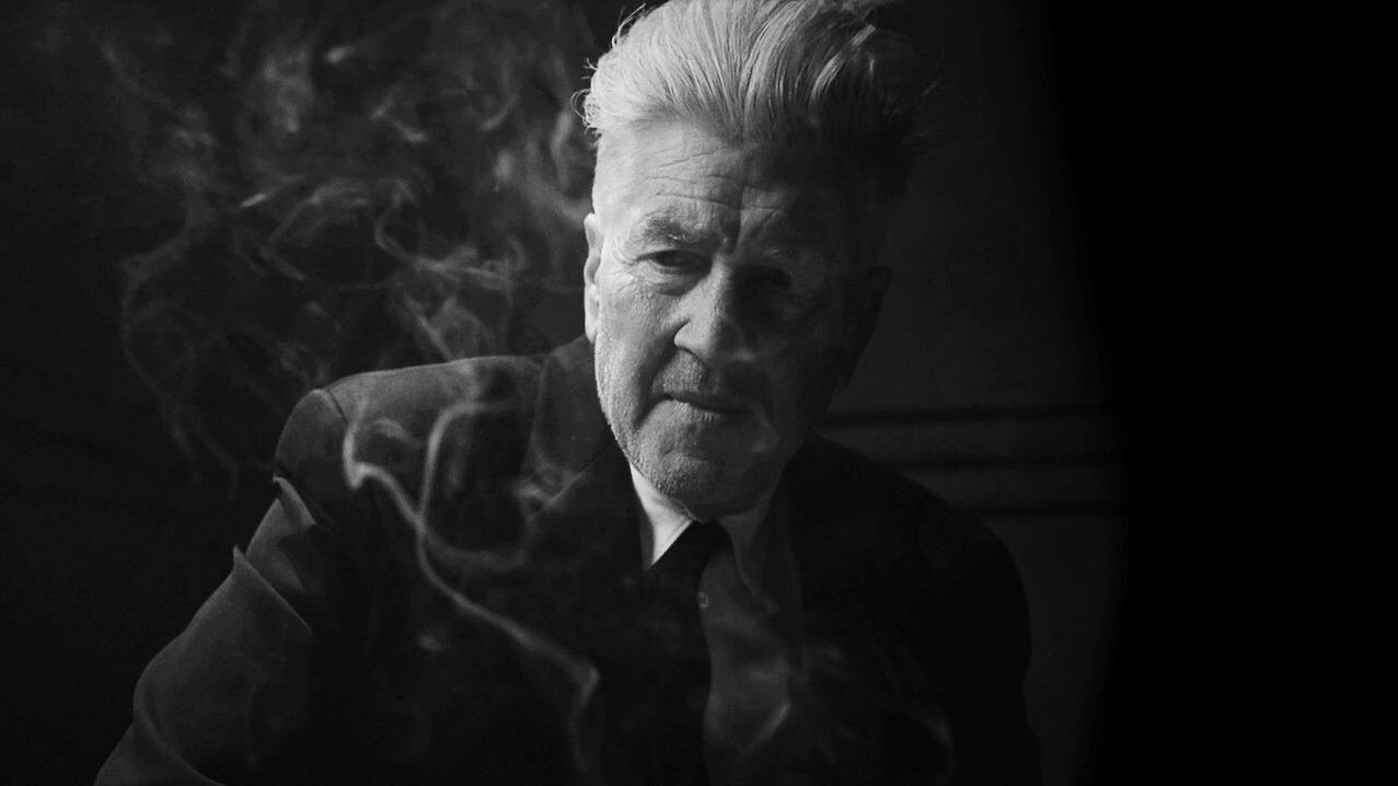 David Lynch, surrounded by smoke, interrogates a monkey