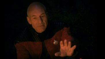 Picard holds his hand up to say wait in Darmok