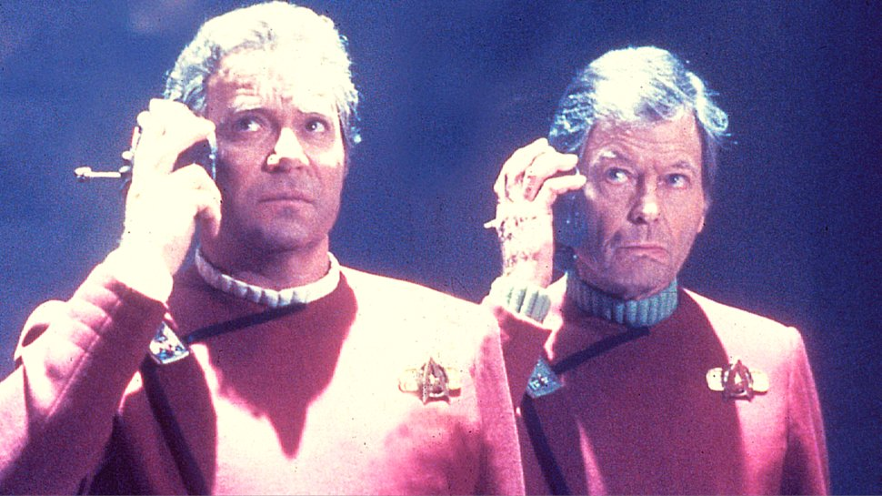 Kirk and McCoy listen to something in the original Star Trek