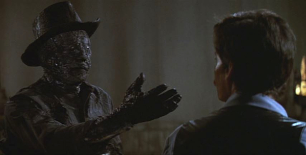 A charred Gunslinger attempts to attack Peter who faces the robot