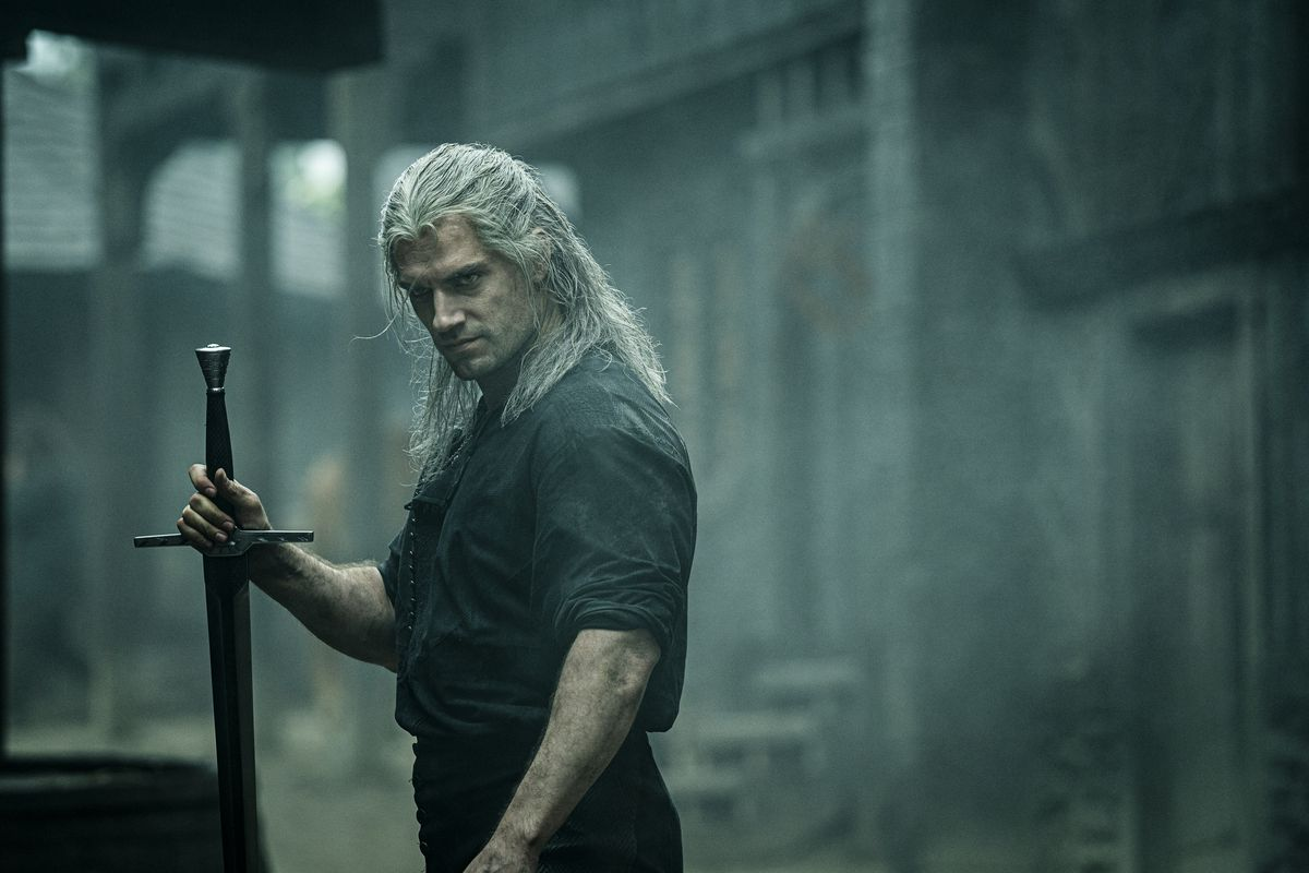 Geralt holds a sword in The Witcher