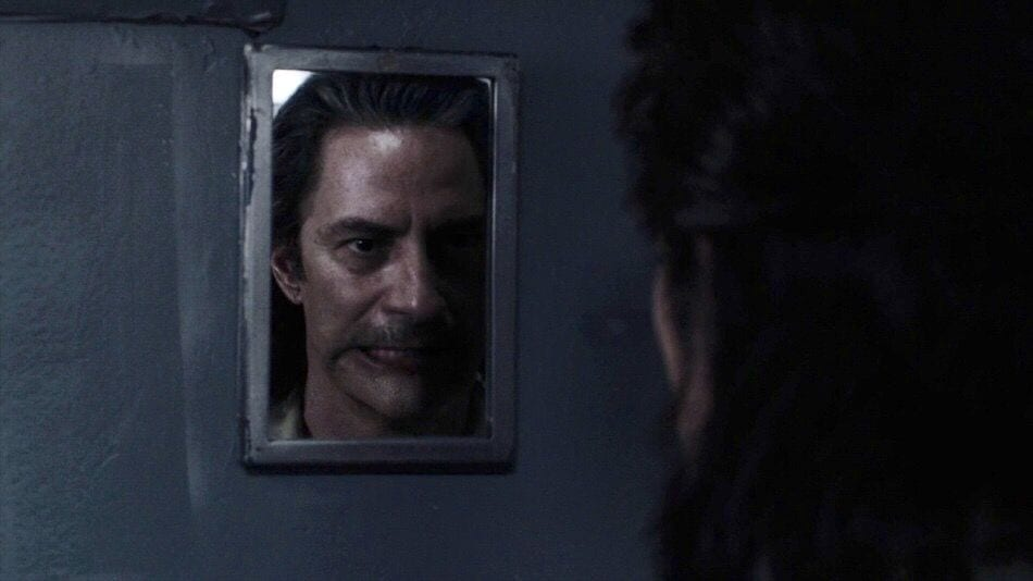 Mr. C looks in the mirror and his face is morphing slightly to look like BOB