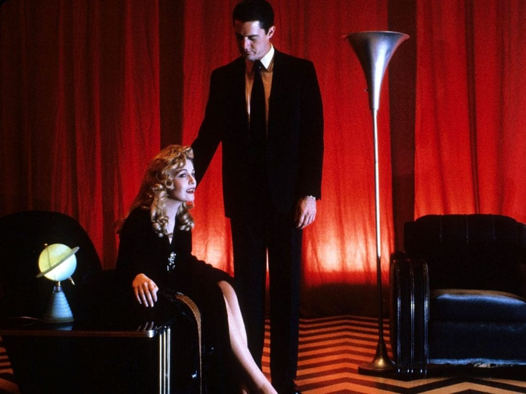 Cooper comforts Laura in the Black Lodge