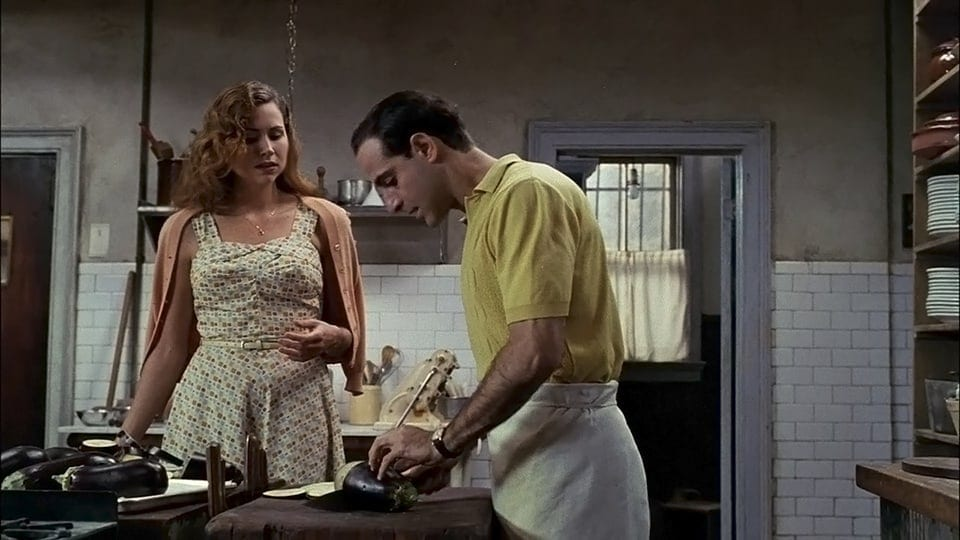 Secondo and Phyllis talk while preparing food in Big Night