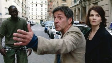 Daniel Auteuil and Juliette Binoche confront a cyclist in Michael Haneke's Caché.