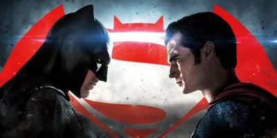 Batman and Superman standing face to face