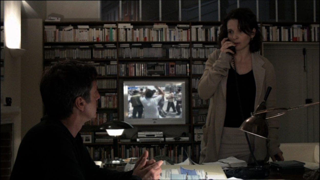 Anne (Juliette Binoche) and Georges (Daniel Auteuil) attempt to confirm by phone that their son may be missing