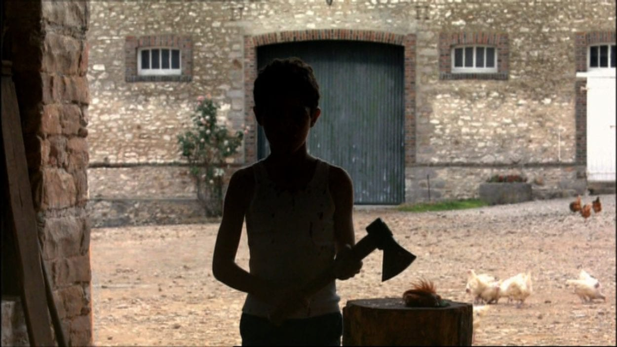 A young Majid cuts the head off a Rooster, the emblematic image of France.