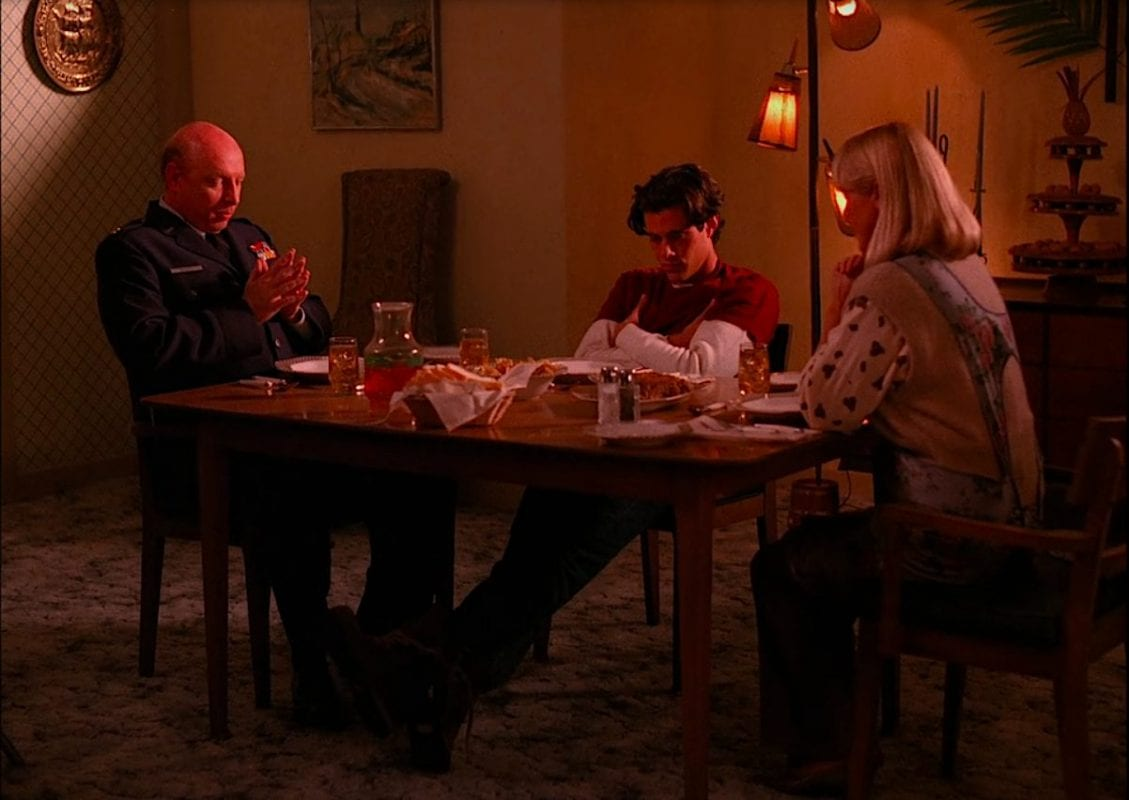 The Briggs family sits at the dinner table