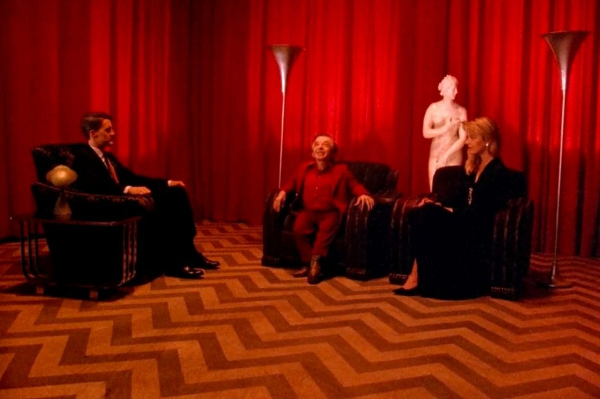 Cooper sits in the Black Lodge with The Arm and Laura