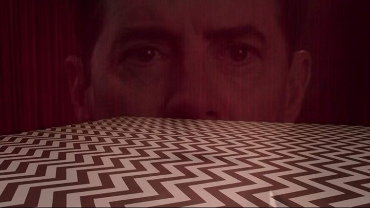 Dale Cooper's disembodied head superimposed over the Chevron-patterned floor of the Red Room