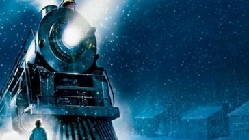 The Polar Express Feature Image Young Boy Looking At A Train With A Single Light Shining With Snow Surrounding Them