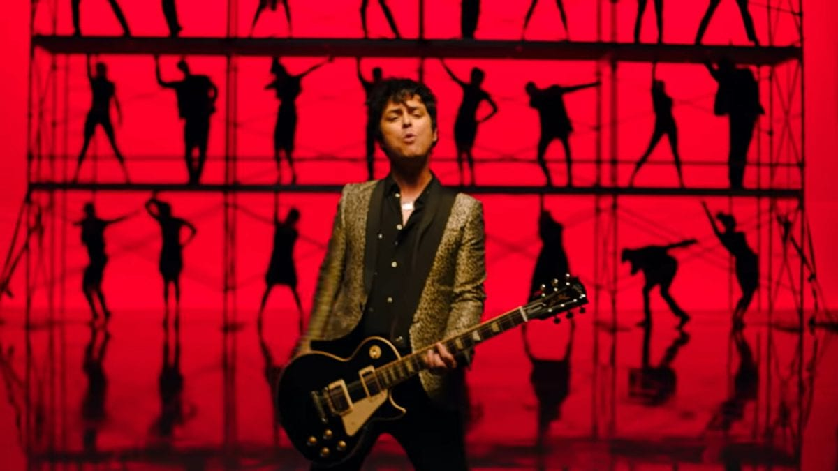 Billy Joe Armstrong and backing dancers in red squares in the video for Green Day's Father of All...
