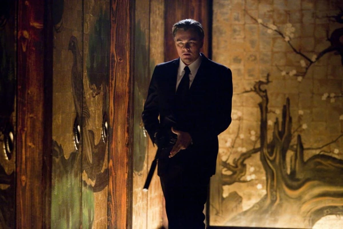 Leonardo DiCaprio in suit with gun in Inception