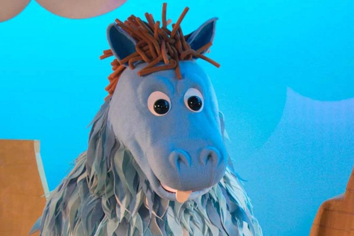 One of the puppets, a giant blue horse, from Kidding