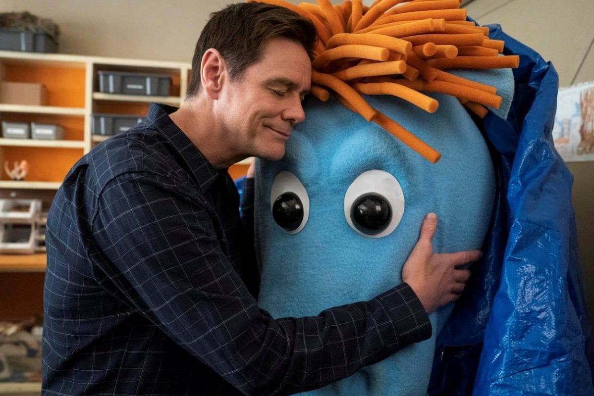Jeff hugs one of his favorite puppets after a long time away