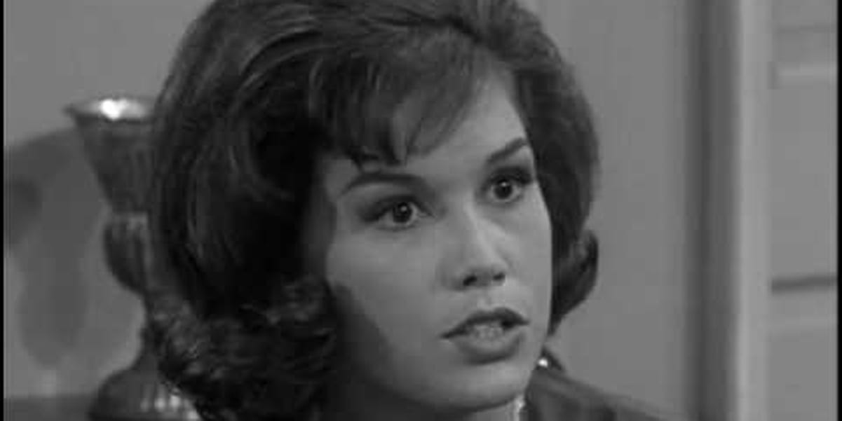 Picture in black and white, Mary Tyler Moore looking straight ahead with intensity, but the camera angle is from the side, capturing Mary Tyler Moore at an angle