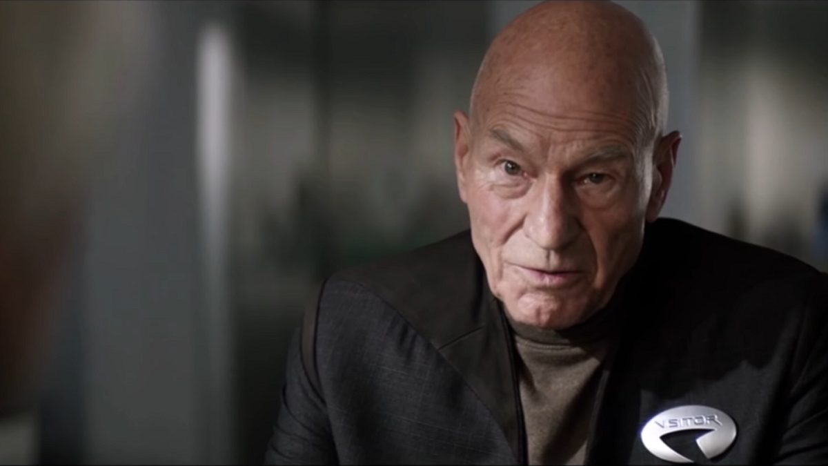 Picard S1E2 - Picard in civilian clothes with a Starfleet visitor badge on his jacket