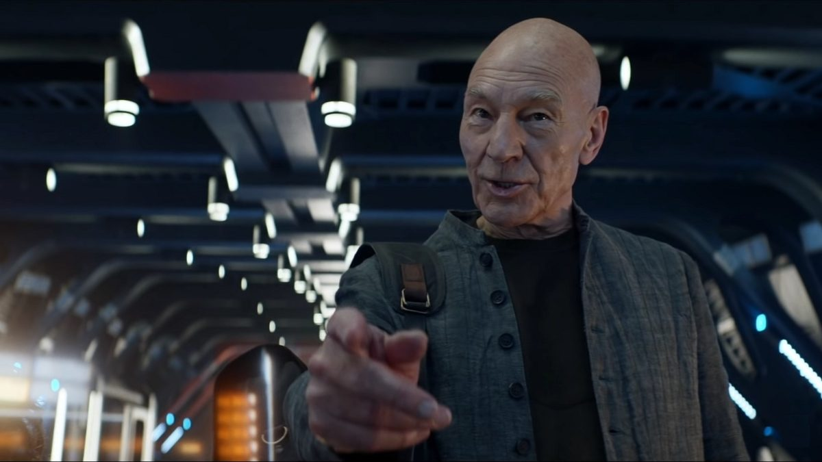 """Picard S1E3 - Picard in civilian clothes on the bridge of a starship making his """"engage"""" hand gesture"""