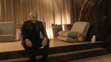 Picard S1E4 - Picard sits on a raised step in a monistary setting
