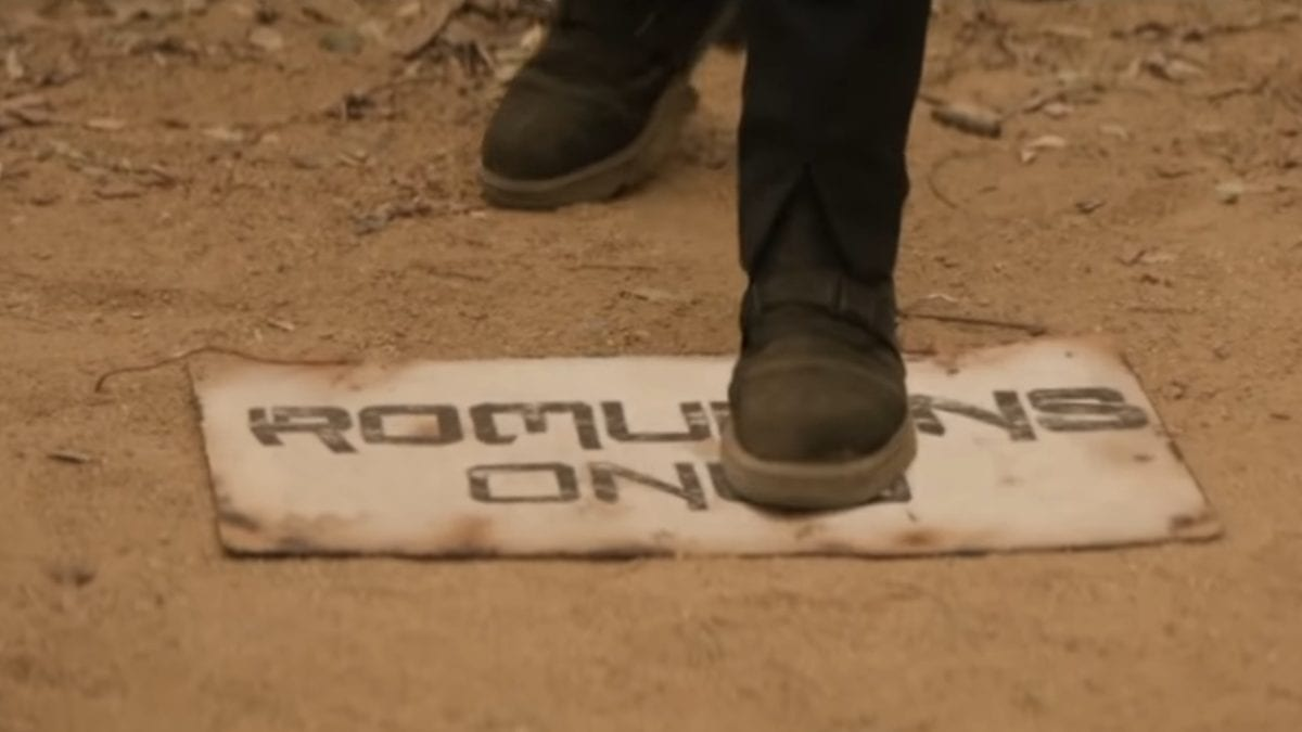 "Picard S1E4 - A booted foot steps on a ""Romulans Only"" sign in the dirt"