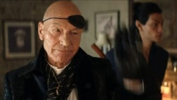 Picard S1E5 Picard in costume as a smuggler with his eye patch flipped up