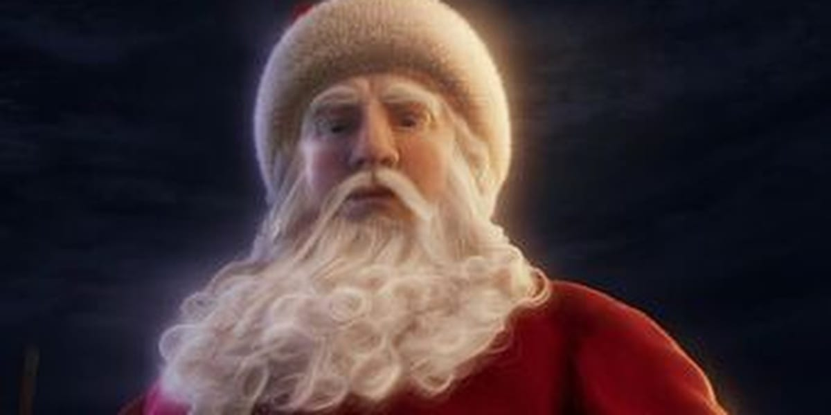 Santa Looking Directly Down, white beard and some of his red suit visible, with a glow around him and a dark background