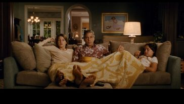 The Descendents family on the sofa together