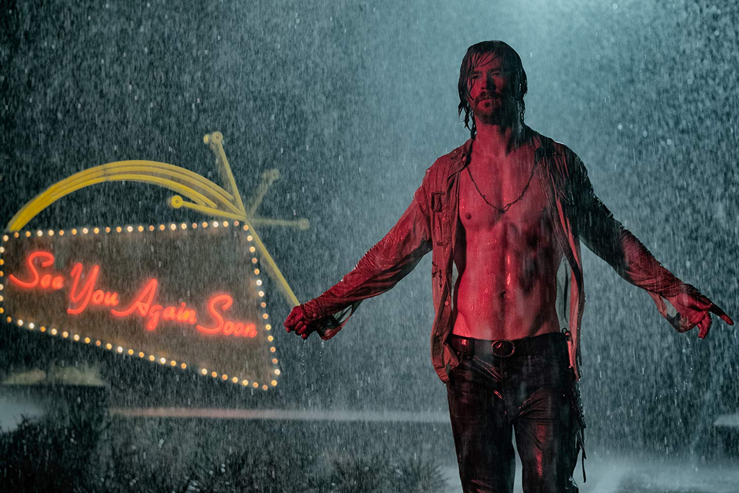 Billy standing in the rain with his shirt open