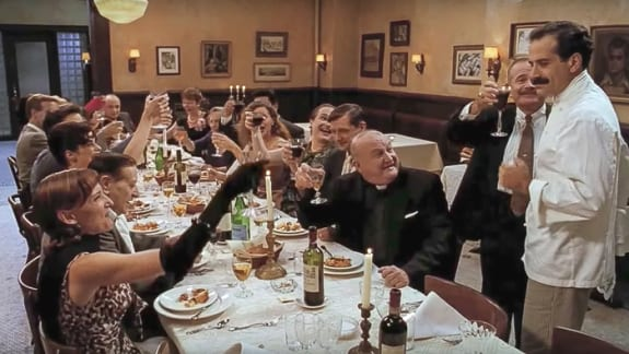 The Big Night as everyone sits at the dining table and raises their glasses to the chef