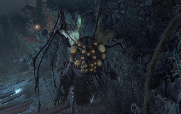 A Mi Go Zombie stands in center frame. It is a humanoid thing with a disgusting, bulbous head resembling a fly and legs sticking out of its neck.