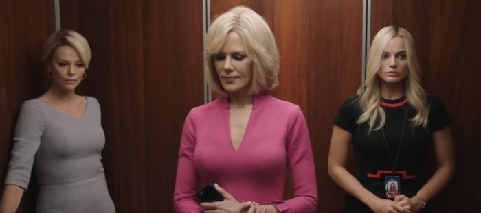 Charlize Theron, Nicole Kidman, and Margot Robbie stand in an elevator