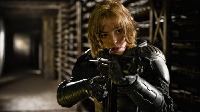 Judge Anderson holds her gun up in a defensive position inside a hallway