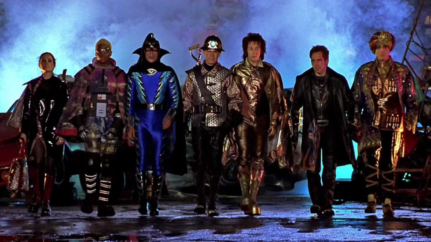 The Mystery Men gather together dressed in the superhero garb ready for battle