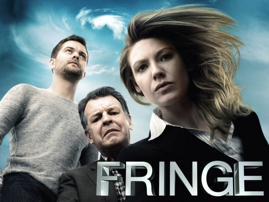 Members of the cast on a title card for Fringe