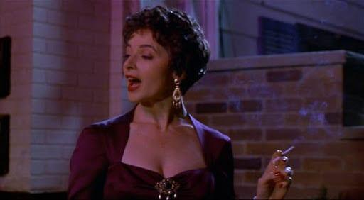 Isabella Rossellini as Gabriella smoking a cigarette in Big Night