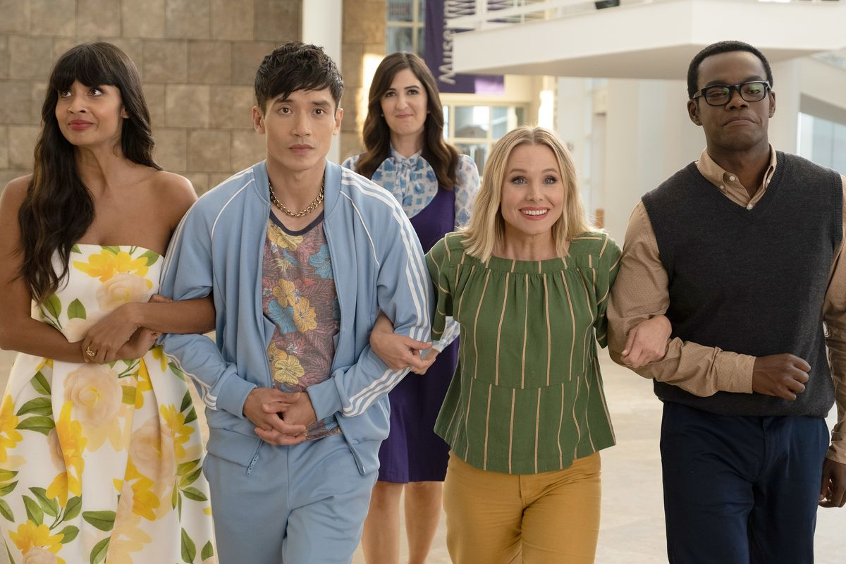 Tahani, Jason, Eleanor, and Chidi lock arms as Janet stands behind them in The Good Place