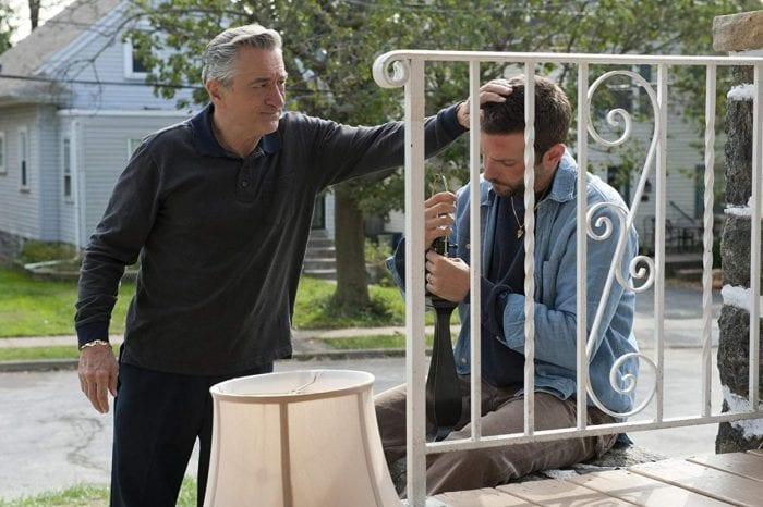 Pat Sr. comforts his son Pat Jr. on their porch.