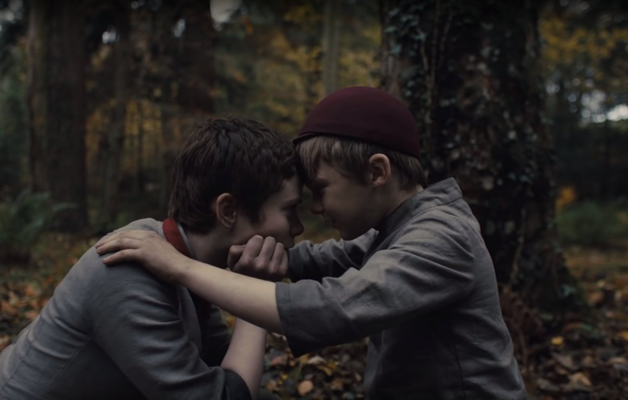 Gretel (Sophia Lillis) and Hansel (Samuel Leakey) press their heads together in an intimate moment