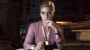 Kim Wexler (Rhea Seehorn) sits at a desk in Better Call Saul
