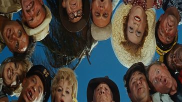 The entire cast in a circle, looking down into the camera