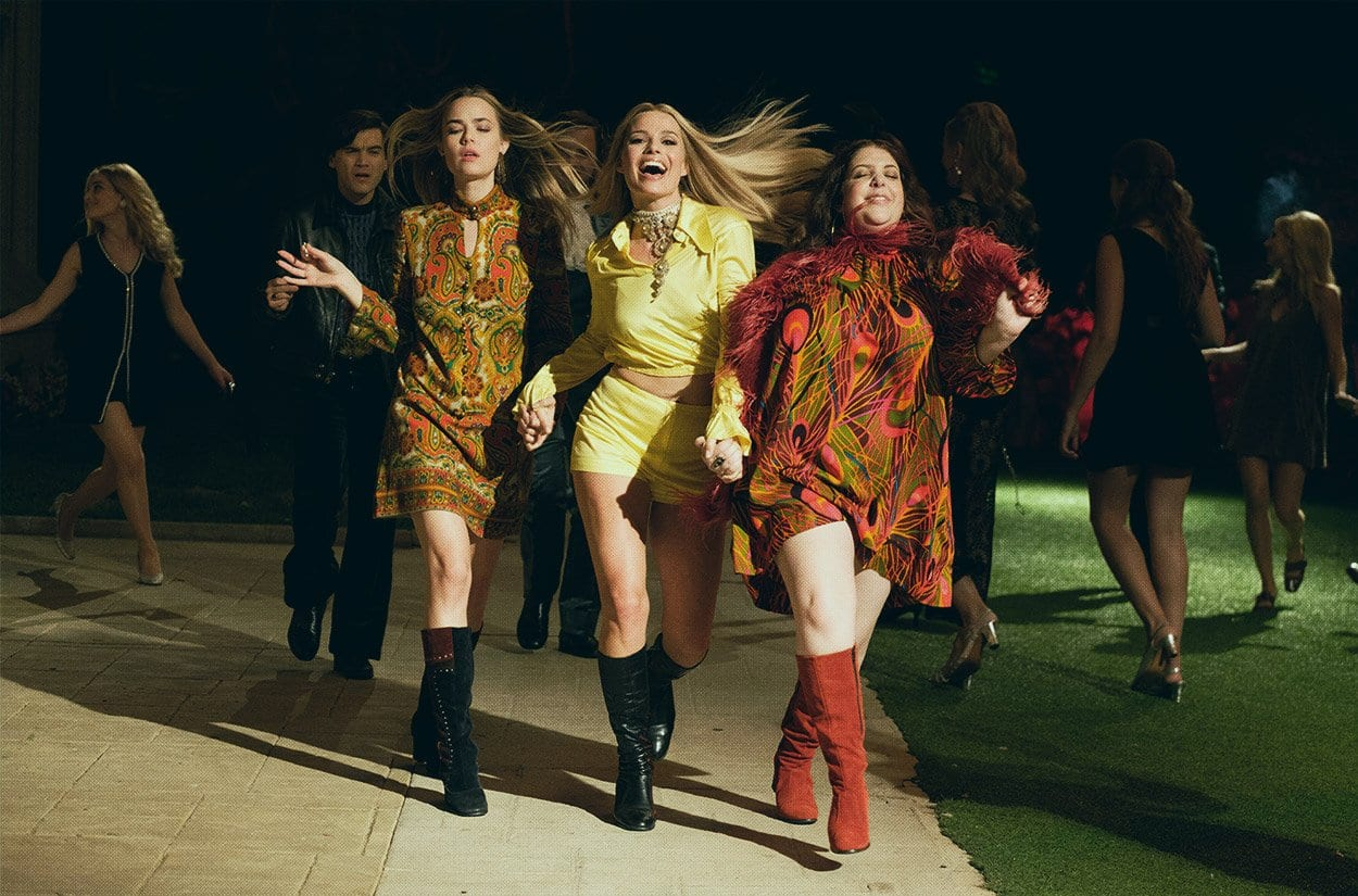Sharon Tate with the women of the mamas and papas strutting at a party