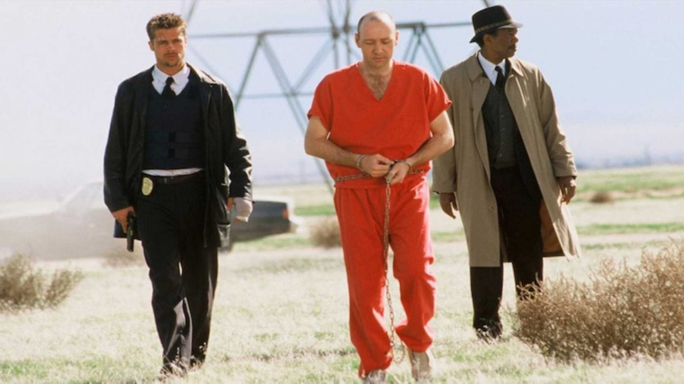 Brad Pitt, Kevin Spacey, and Morgan Freeman walking towards the camera in the desert