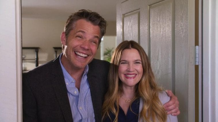 Joel (Timothy Olyphant) and Sheila (Drew Barrymore) put on fake smiles to greet someone at the door.